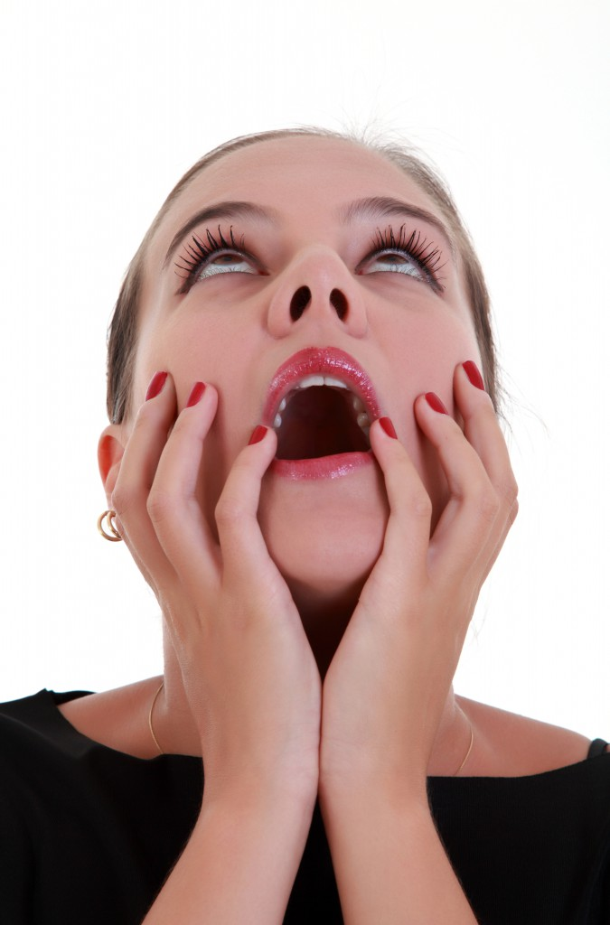 Portrai of afraid screaming young woman